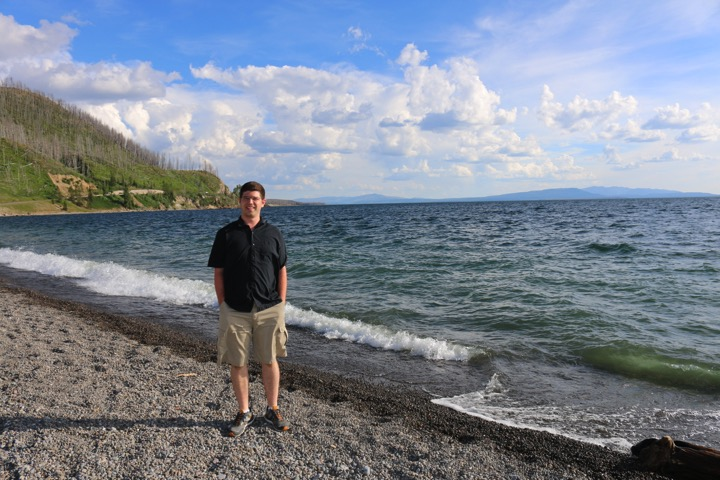 posing with Yellowstone Lake